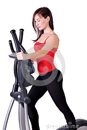 Girl fitness exercise cross trainer