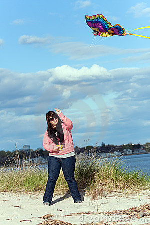 Free Girl Flies A Kite At The Sea Shore Royalty Free Stock Images - 19552089