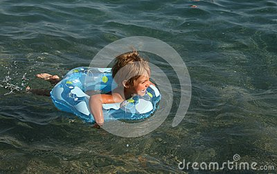 Girl floats on a lifebuoy ring