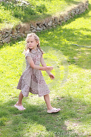 Girl in flowered dress looking back