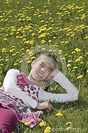 Girl in the flowering meadow laughing