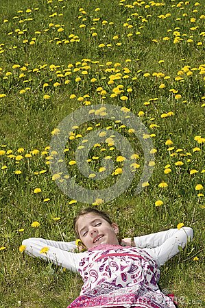 Girl in the flowering meadow resting