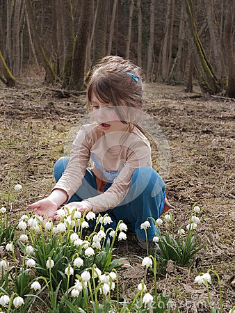 Girl with flowering snowflake