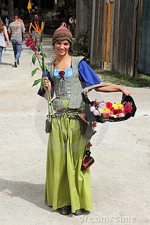 Girl with flowers dressed in medieval costume Editorial Image