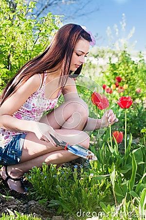 Girl with flowers in garden