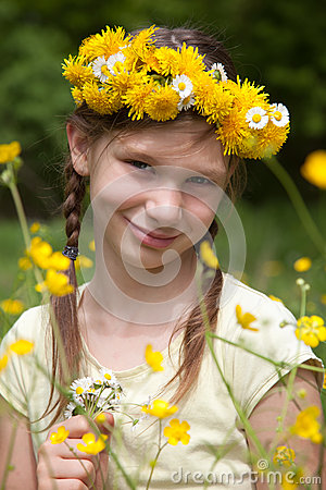 Girl with flowers on her head in nature