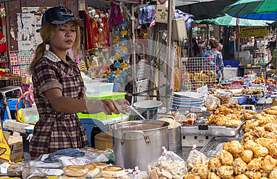 Girl on food stall Editorial Image