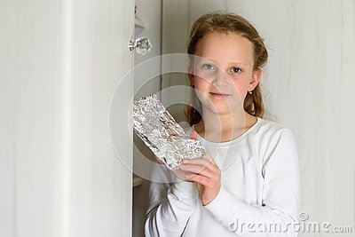Girl with Afikoman is a half-piece of matzah which is broken of the Passover Seder. Stock Photo