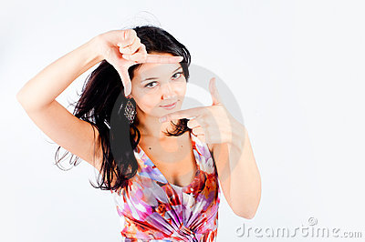 Girl with frame gesture. Focus on fingers