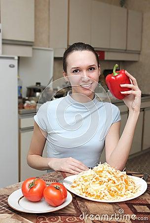 Girl with fresh salad