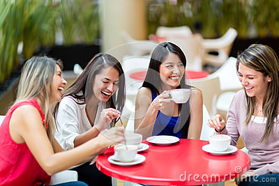 Girl friends meeting for coffee