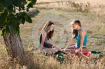 Girl friends on a picnic