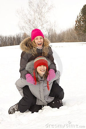 Girl friends playing in snow