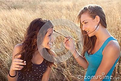 Girl friends in wheat field