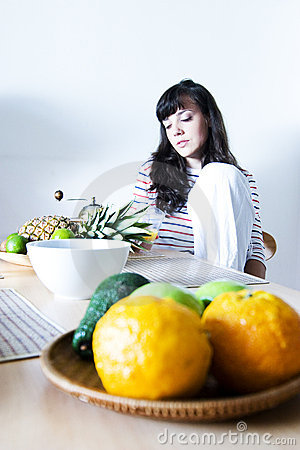 Girl in front of bowl of fruit
