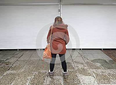 Girl in front of closed shops