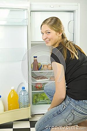 Girl in front of fridge