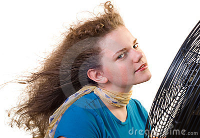 A girl in front of a large fan