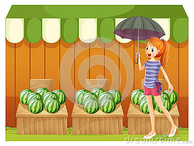 A girl in front of the watermelons