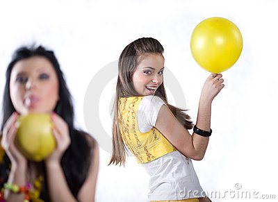 Girl with fruit and girl with yellow balloon