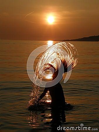 Girl in fun on sea sunset