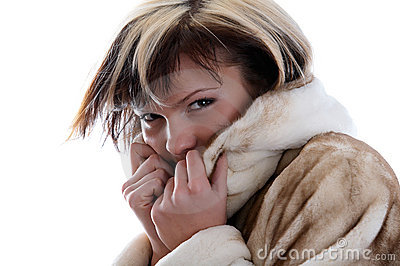 Girl in fur coat on white background