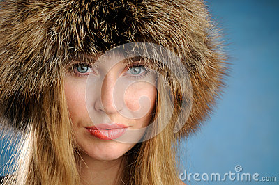 Girl with a fur hat.