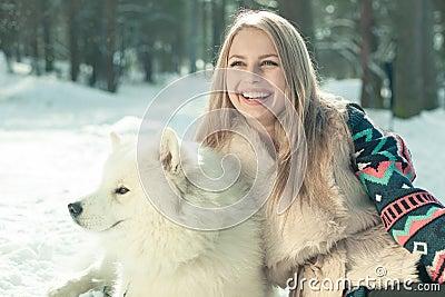 Girl with samoed dog
