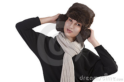 Girl with fur hat and with scarf with fun pose