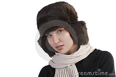 Girl with fur hat and with scarf looking
