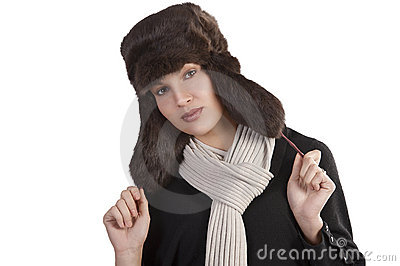 Girl with fur hat and with scarf posing