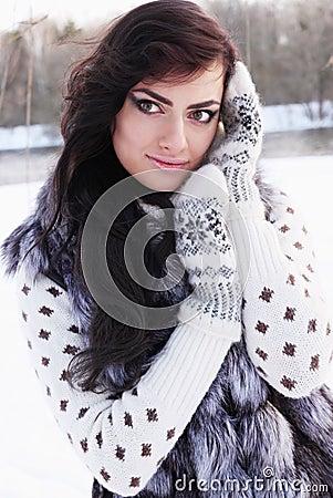 Girl in a fur vest
