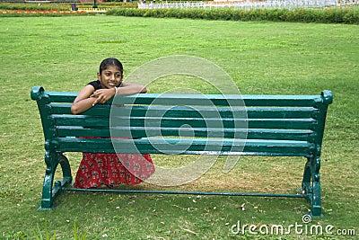 Girl on a Garden Bench