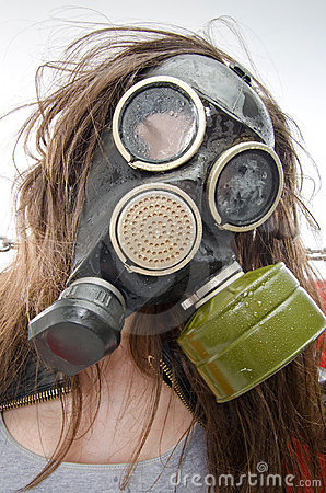 Girl in a gas mask. Bad ecology concept