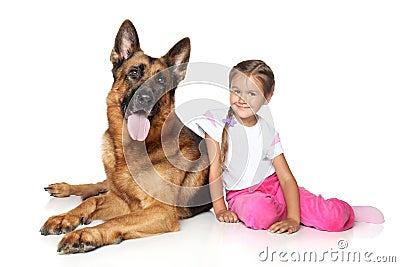 Girl and German shepherd dog