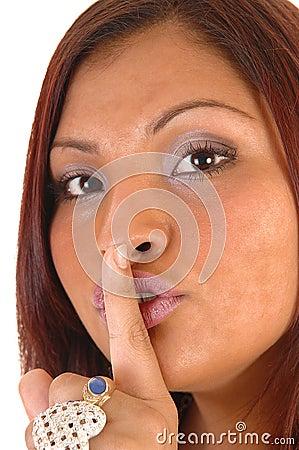 Girl gesturing quiet.