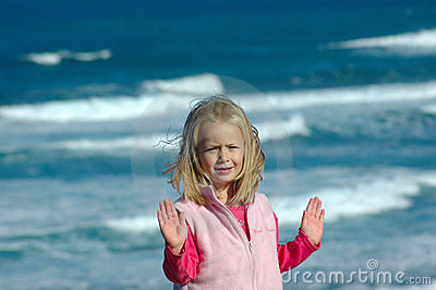 Girl gesturing stop by sea