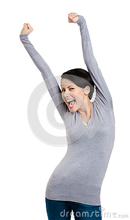 Girl gesturing triumphal fists puts her hands up