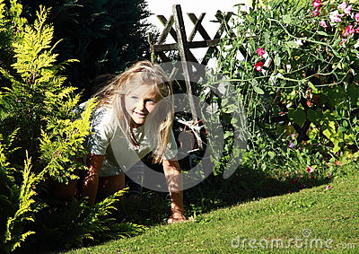 Girl getting out from bush
