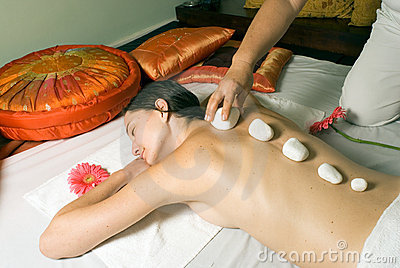 Girl Getting Rocks Placed on Spine - horizontal