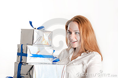 Girl with a gift on a light background