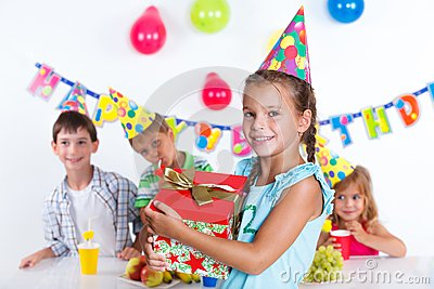 Girl with giftbox at birthday party