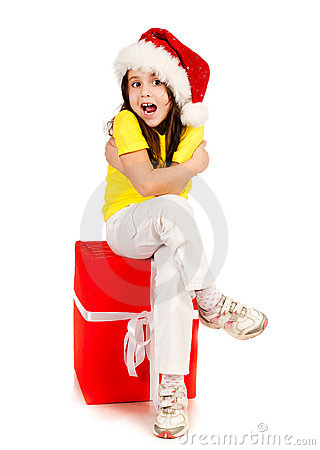Girl with gifts in santa hat