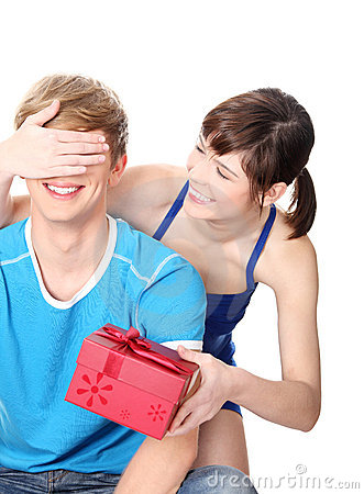 Girl give a gift to her boyfriend.