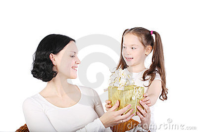Girl gives to mum a gift.