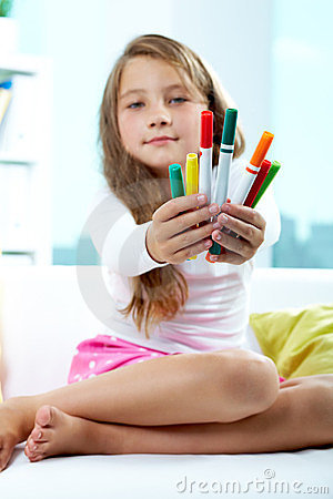 Girl giving crayons