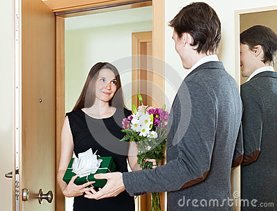 Girl giving flowers and present