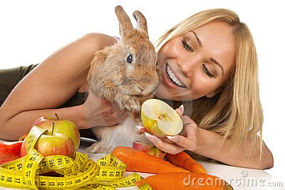 Girl giving fresh vegetables to bunny