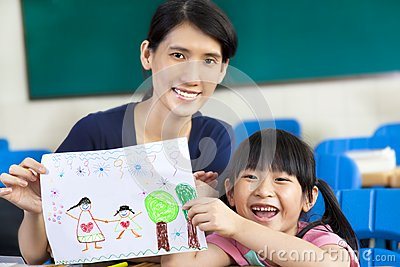 girl giving mother a drawing