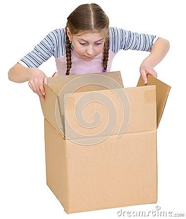 Girl glance at cardboard box